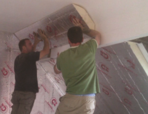 Insulation being fitted to a sloping ceiling